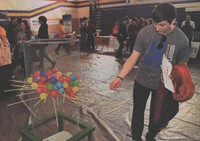 Champion High School freshman Tyler Rupe, 15, plays a game similar to Kerplunk while attending the Yes Fest, sponsored by Regeneration Church of Champion, held Monday in the school gymnasium.