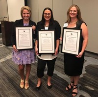 Three Kindergarten Teachers holding awards