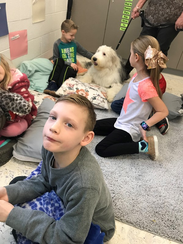 Our students in Miss Luklan's class have fallen in love with Duke the therapy dog.