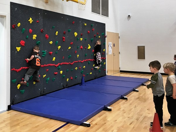 Students are enjoying using the new rock wall in the elementary school gym!