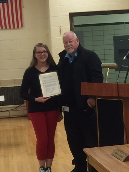 My Boyle presents recognition to student selected for Stambaugh Youth Concert Band