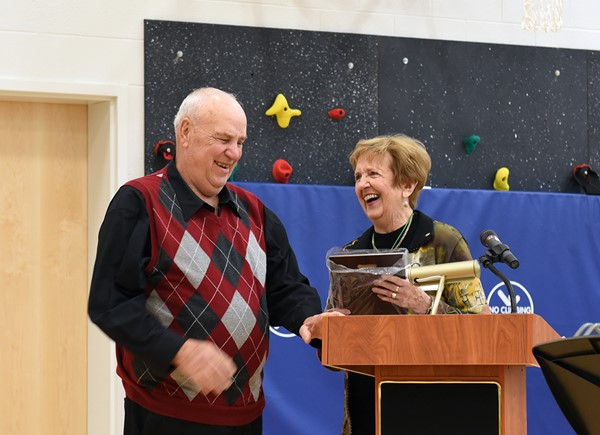 Merial Price, Rotary past President, presents Bob Smith with Rotary's 2018 Senior Citizen of the Year Award.