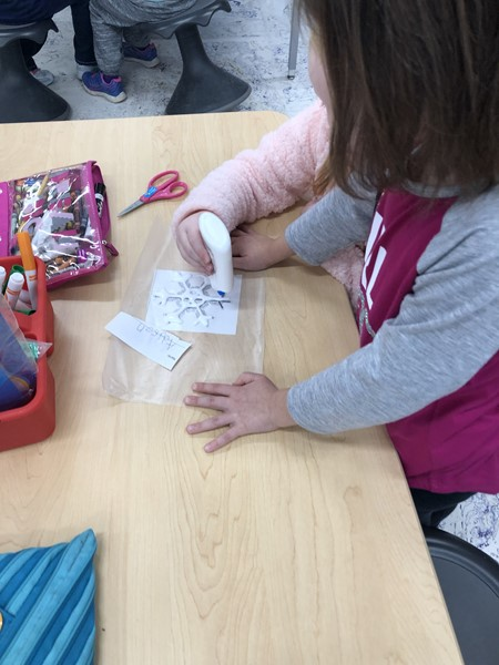 Crafting snowflakes in kindergarten.