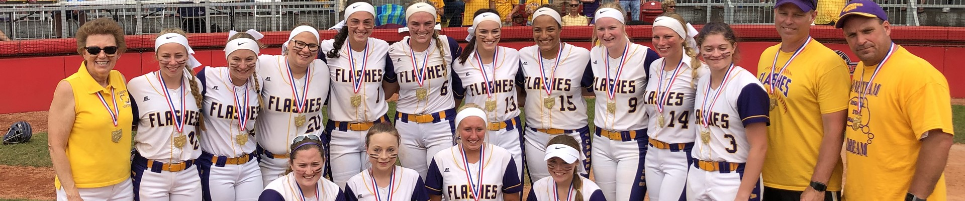 Lady Flashes Softball team and coaches posing after winning the state title.