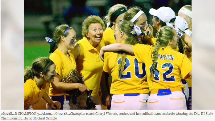 Coach Weaver and Softball team smiling with joy after winning