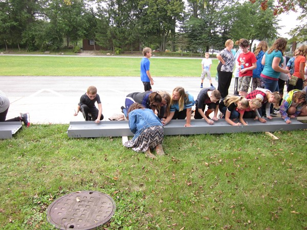 Signing the beam for the new K-8 building