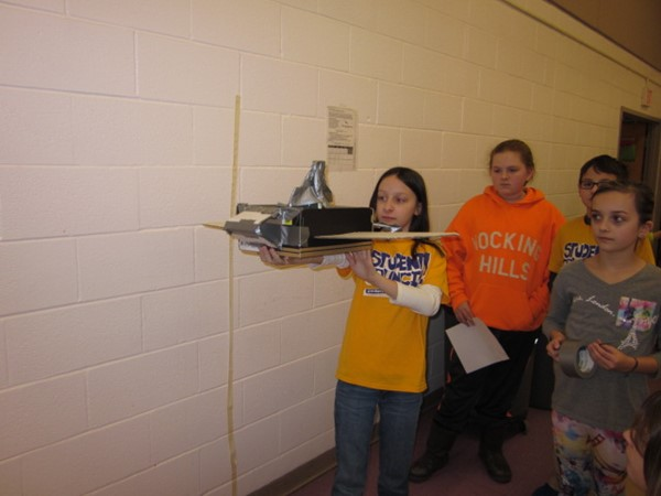 "All of the fifth grade Science classes have spent several class days participating in the NASA ""Let it Glide"" STEM challenge for middle school students. Natalie Kittle gets ready to test their groups glider."