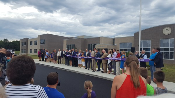 Ribbon Cutting outside in front of the new building