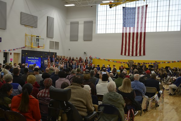 Elementary students, directed by Mr. Josh Cokrlic, sang for the veterans.