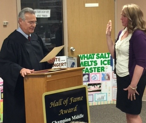 Probate Judge James Fredericka gives the Oath of Office to Patricia Fisher at the April 24 Board of Education meeting.  Mrs Fisher is filling the open board seat.