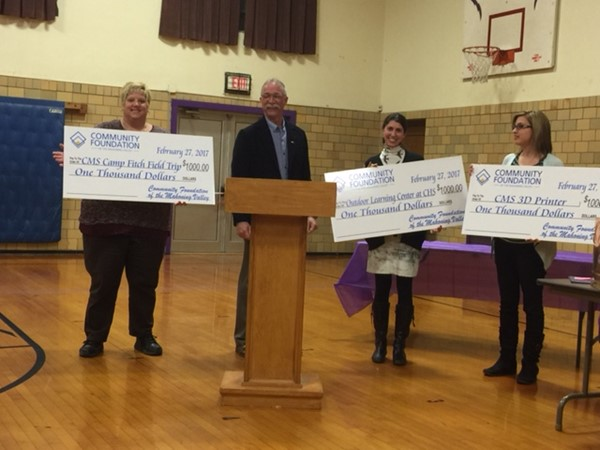 Russ Banks, President of Champion Schools Educational Enrichment Fund awards teacher mini grants of $1000 each to 3 Champion school classrooms.