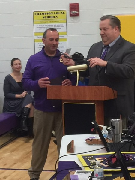 Golf coach recognized