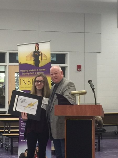 Board member honors student achievement