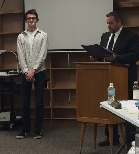Board member John Pitts recognizes 2017 Valedictorian Joshua Boyd