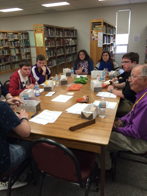 Board members meet with high school seniors and juniors to gather their thoughts on school topics